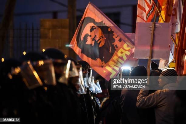 TOPSHOT A demonstrator holds a flag with an image of revolutionary leader Ernesto 'Che' Guevara during the blockade of the PanAmerican highway in...