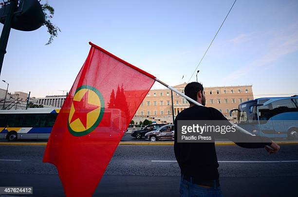 A demonstrator holds a giant Kurdish flag standing in front of the Greek Parliament Kurdish people living in Athens organized a demonstration in...