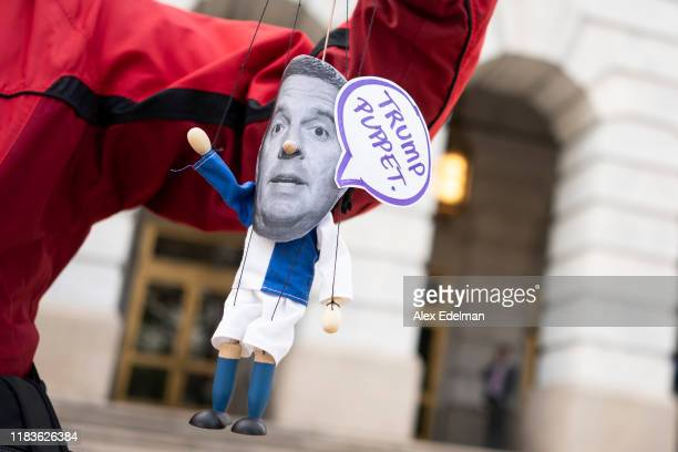 A demonstrator holds a homemade puppet of Ranking Member Devin Nunes as Gordon Sondland the US ambassador to the European Union testifies before the...