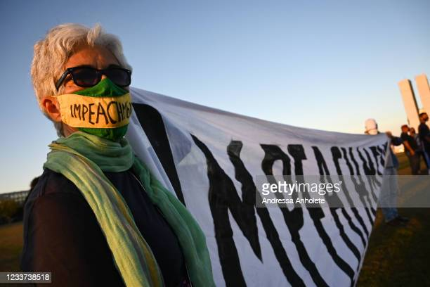 Demonstrator holds a large flag that reads impeachment during a protest against the government ofPresident of Brazil Jair Bolsonaro in front of the...