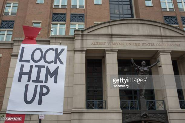 A demonstrator holds a Lock Him Up sign before the trial of former Trump Campaign Manger Paul Manafort outside of District Court in Alexandria...