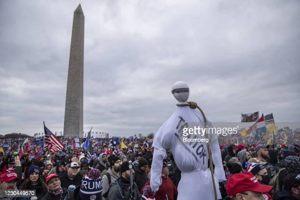 "Demonstrator holds a mannequin wearing a noose with ""Traitor"" written on it during a protest at the Washington Monument in Washington, D.C., U.S., on..."