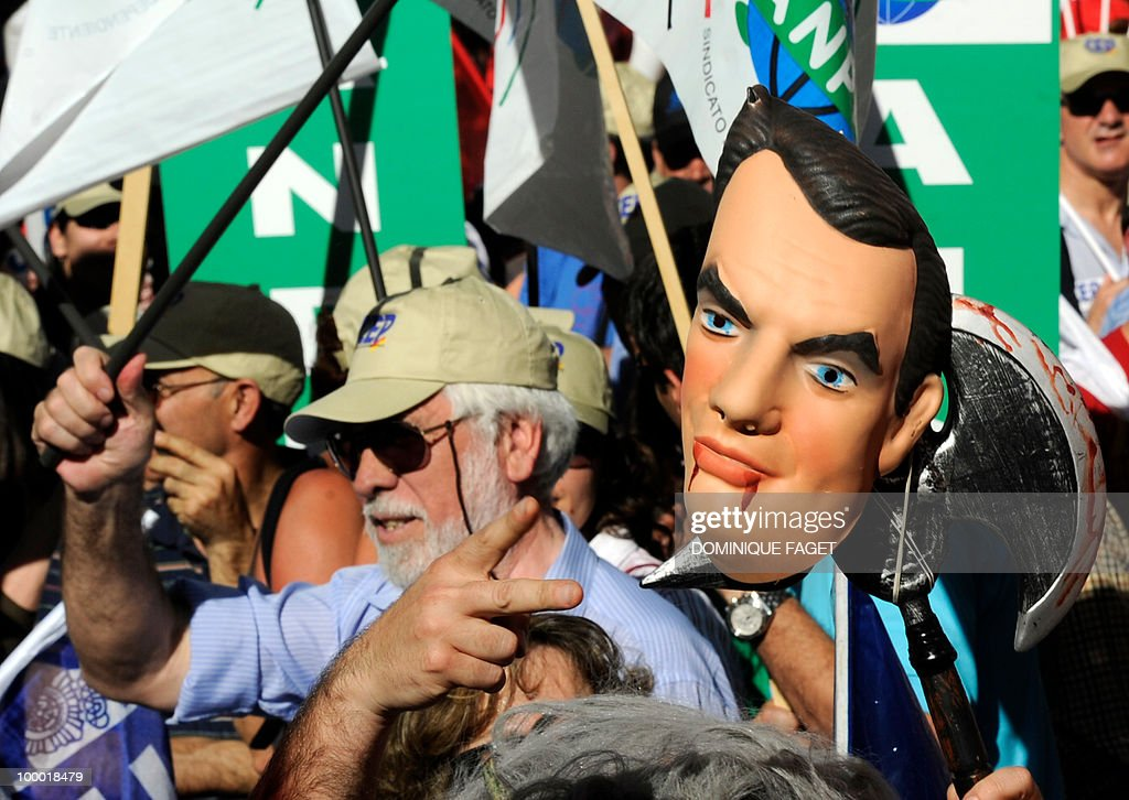 A demonstrator holds a mask of Spanish Prime minister José Luis Rodríguez Zapatero during a demonstration of thousands of public servants against the austerity measures of the Spanish government. Thousands of public sector workers took to the streets of Spain Thursday to protest a tough government austerity plan aimed at reining in the public deficit and easing fears of a Greek-style debt crisis.