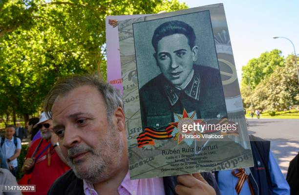 A demonstrator holds a picture of Rubén Ruiz Ibárruri son of Spanish Comunist leader Dolores Ibárruri La Pasionaria killed fighting with USSR Army...