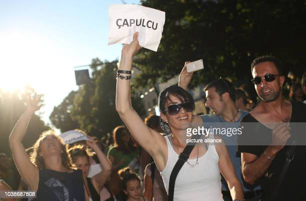 A demonstrator holds a piece of paper in her hands which reads 'Capulcu' during a protest rally at the Fête de la Musique event in the Kreuzberg...