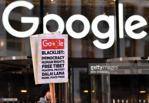 A demonstrator holds a placard as they protest outside the offices of Google in London on January 18 2019 A global coalition of 60 human rights and...