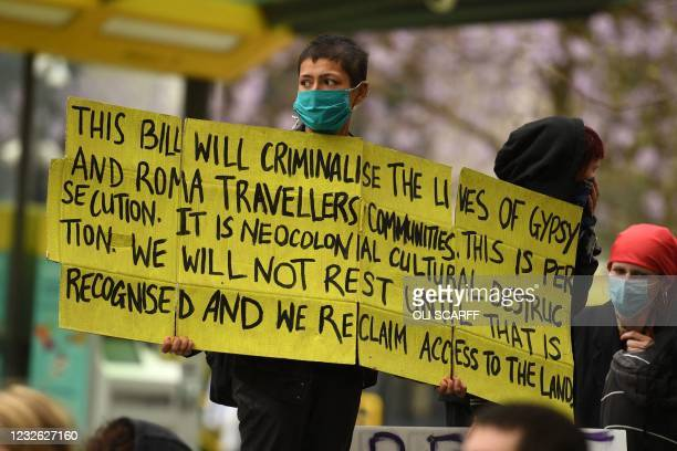 Demonstrator holds a placard at a protest against the Police, Crime, Sentencing and Courts Bill 2021 in central Manchester on May 1, 2021. - Previous...
