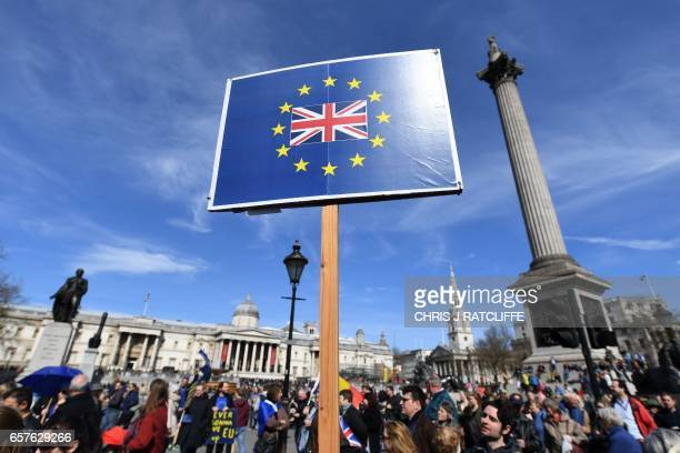 A demonstrator holds a placard depicting a Union flag and the stars of the EU flag during an anti Brexit proEuropean Union march in London on March...