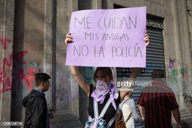 A demonstrator holds a placard during a rally on International Women's Day in Mexico City Mexico on Friday March 8 2020 The United Nations first...