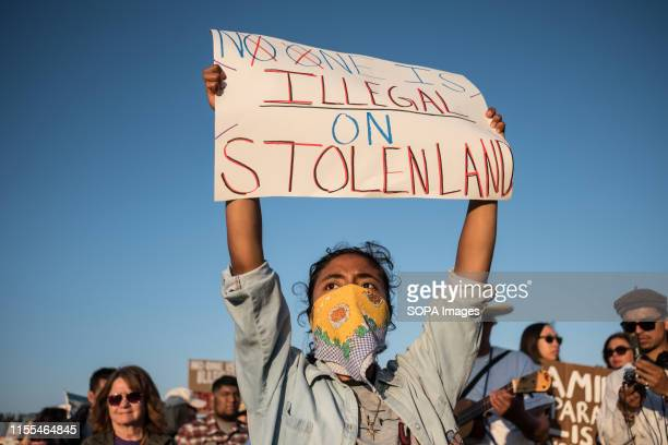 Demonstrator holds a placard during the protest Over one thousand people gathered in San Ysidro near the US Mexico border to protest against...