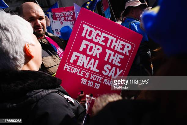 A demonstrator holds a placard for the mass 'Together for the Final Say' march organised by the 'People's Vote' campaign for a second Brexit...