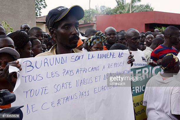 A demonstrator holds a placard reading Burundi be the example for African countries to refuse the abuse and discrimination from some European...