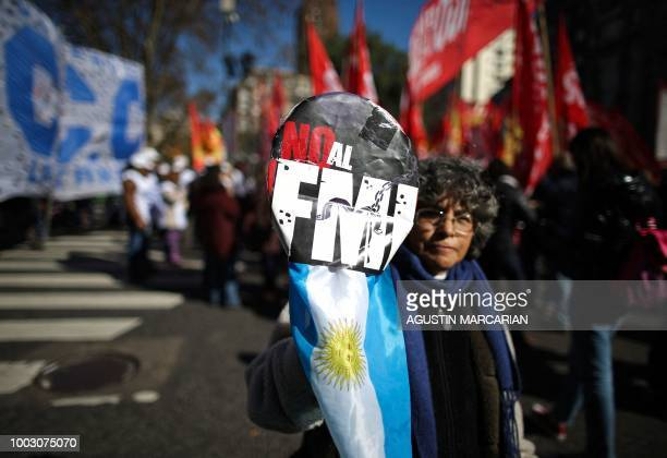 A demonstrator holds a placard reading 'No to IMF' during a protest against Argentina's latest agreement with the International Monetary Fund in...