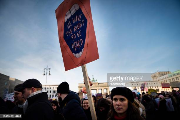 A demonstrator holds a placard reading 'We have the right to be heard' during the Berlin chapter of the Women's March Global near the Brandenburg...