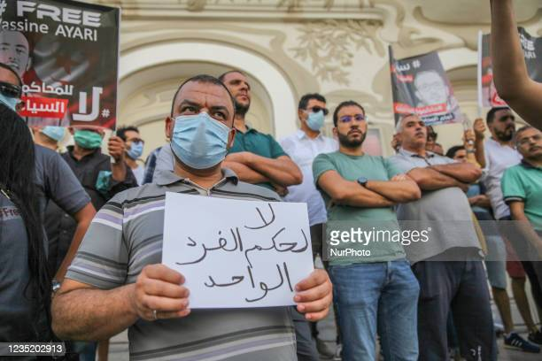 Demonstrator holds a placard that reads in Arabic no to the one-man rule during a demonstration held in Tunis, Tunisia, on September 11 to call for...