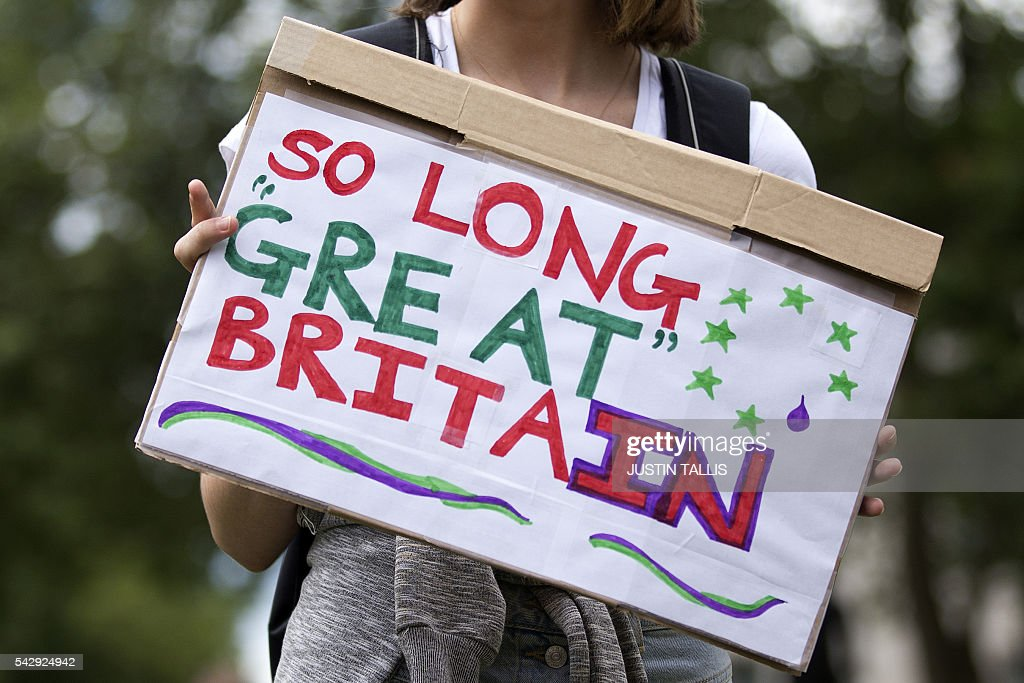 A demonstrator holds a placard that reads 'So Long Great Britain' during a protest against the pro-Brexit outcome of the UK's June 23 referendum on the European Union (EU), in central London on June 25, 2016. The result of Britain's June 23 referendum vote to leave the European Union (EU) has pitted parents against children, cities against rural areas, north against south and university graduates against those with fewer qualifications. London, Scotland and Northern Ireland voted to remain in the EU but Wales and large swathes of England, particularly former industrial hubs in the north with many disaffected workers, backed a Brexit. / AFP / JUSTIN