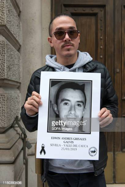Demonstrator holds a placard with a photo of a social leader killed in Colombia during the protest Demonstrators gathered outside Gibson Hall to...