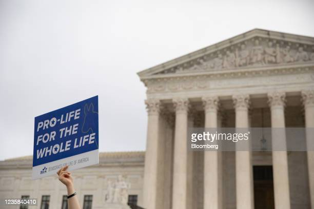 Demonstrator holds a pro-life sign in front of of the U.S. Supreme Court in Washington, D.C., U.S., on Tuesday, Oct. 12, 2021. Louisville's EMW...