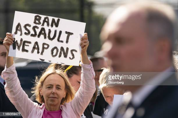 Demonstrator holds a protest sign as House Minority Whip Steve Scalise, a Republican from Louisiana, speaks during a press conference on gun violence...