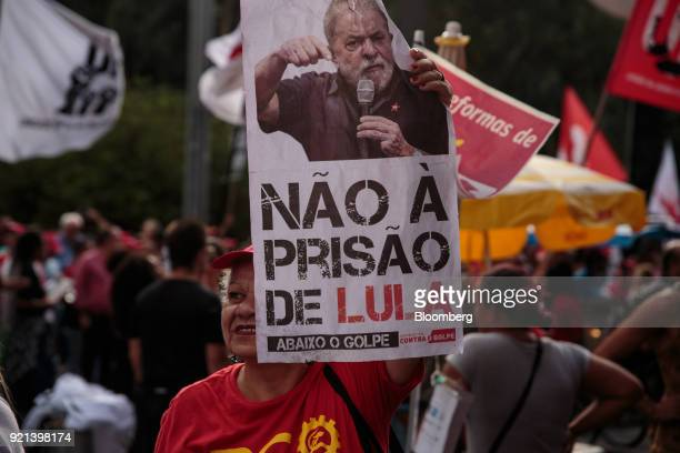 A demonstrator holds a sign against a prison sentence for Luiz Inacio Lula da Silva Brazil's former president during a protest against pension reform...