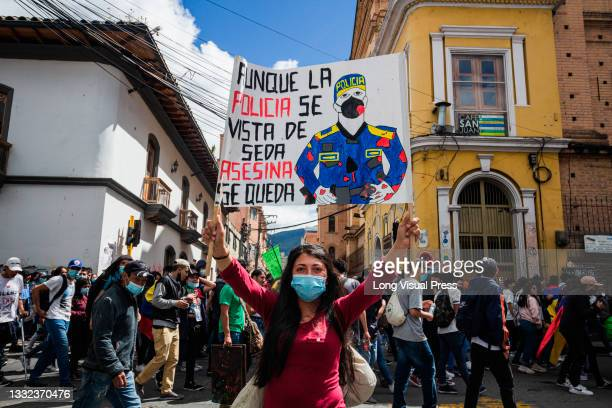 Demonstrator holds a sign against police unrest as demonstrations ended in late-night clashes between riot police and Demonstrators as Colombia marks...
