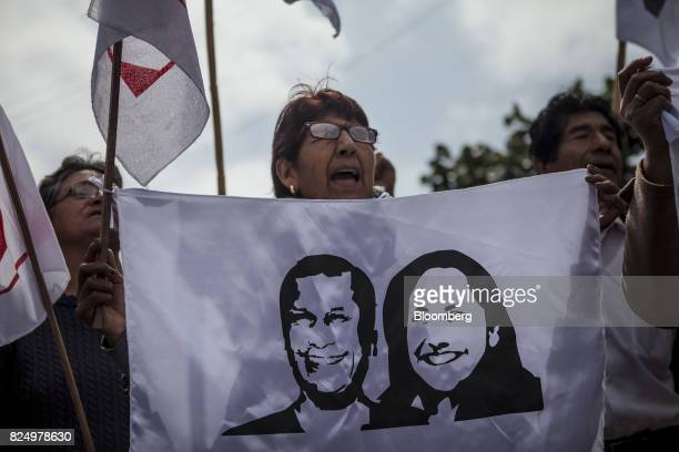 A demonstrator holds a sign depicting images of former Peruvian President Ollanta Humala and his wife Nadine Heredia during a protest against their...