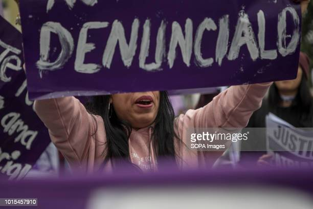 A demonstrator holds a sign during a Ni Una Menos rally in protest against gender based violence in Lima Ni Una Menos demands that women should be...