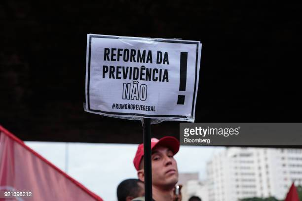 A demonstrator holds a sign during a protest against pension reform in Sao Paulo Brazil on Monday Feb 19 2018 There may be a new twist in the fate of...