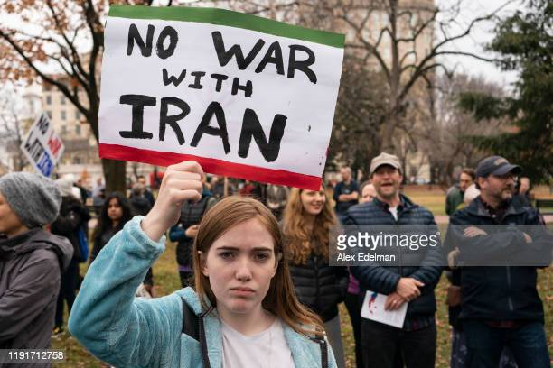 Demonstrator holds a sign during a protest against war in Iraq and Iran outside the White House on January 4, 2020 in Washington, DC. Demonstrations...
