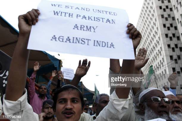 A demonstrator holds a sign during an antiIndia protest in Karachi Pakistan on Wednesday Feb 27 2019 Pakistani fighter jets have shot down two Indian...