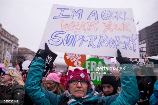 A demonstrator holds a sign during the 2019 Women's March on January 19 2019 in Washington DC Demonstrations are slated to take place in cities...