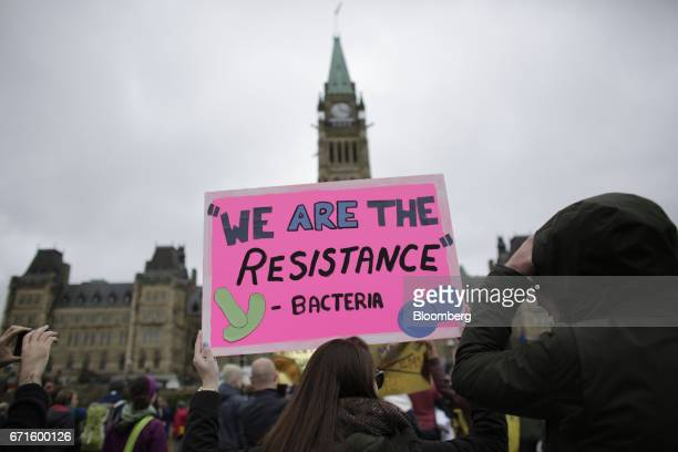 A demonstrator holds a sign during the March for Science rally on Earth Day at Parliament Hill in Ottawa Ontario Canada on Saturday April 22 2017 The...