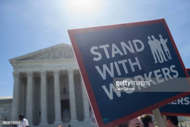 A demonstrator holds a sign in front of the US Supreme Court on June 25 2018 in Washington DC The high court is expected to issue decisions in six...
