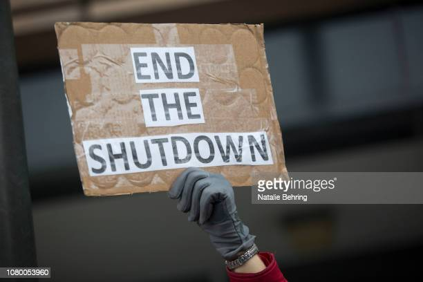 Demonstrator holds a sign protesting the government shutdown at the James V. Hansen Federal Building on January 10, 2019 in Ogden, Utah. As the...