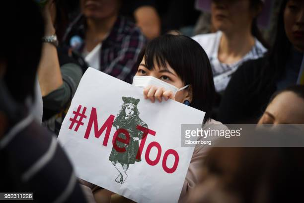 A demonstrator holds a sign reading #Me Too during a rally against sexual harassment in Shinjuku Tokyo on Saturday April 28 2018 Japan's finance...