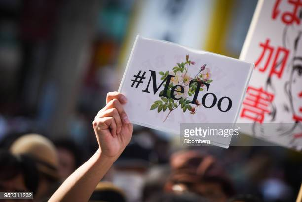 A demonstrator holds a sign reading '#Me Too' during a rally against sexual harassment in Shinjuku Tokyo on Saturday April 28 2018 Japan's finance...