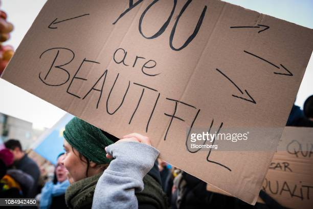 A demonstrator holds a sign reading 'You are beautiful' as she as marches during the Berlin chapter of the Women's March Global near the Brandenburg...