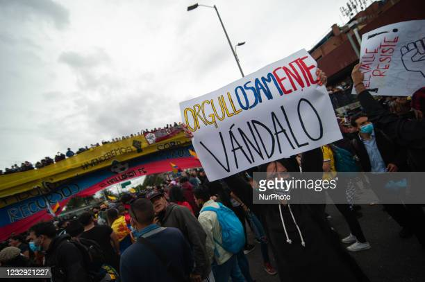 """Demonstrator holds a sign that reads """"Proud to be a Vandalizer"""" as more than 12000 Colombians gather at Monumento a los Heroes to protest..."""