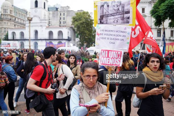 A demonstrator holds a sign that reads 'Women who are victims of violence are the ones left homeless' during a Ni Una Menos rally in protest of...