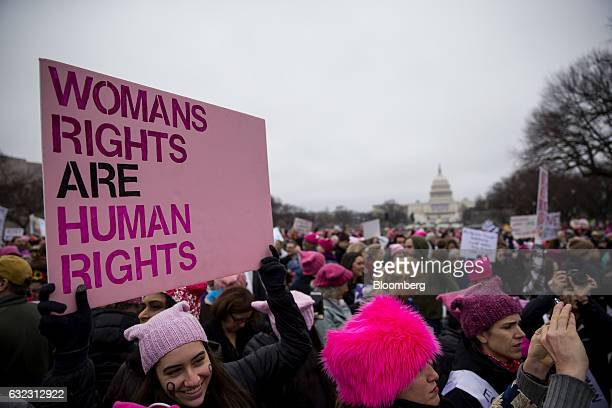 A demonstrator holds a sign while gathering on the National Mall during the Women's March on Washington in Washington DC US on Saturday Jan 21 2017...