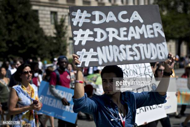 A demonstrator holds a sign while protesting the end of the Deferred Action for Childhood Arrivals program in Washington DC US on Tuesday Sept 5 2017...