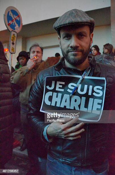 A demonstrator holds a sign with the phrase 'Je Suis Chrarlie on itA vigil was organised outside the Institut Français de Grèce in memoriam of the 12...