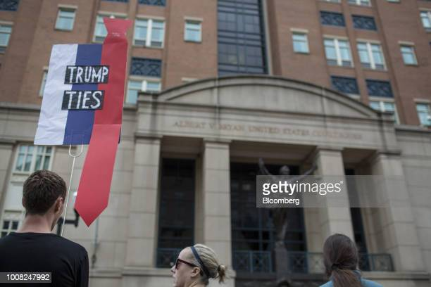A demonstrator holds a Trump Ties sign before the trial of former Trump Campaign Manger Paul Manafort outside of District Court in Alexandria...