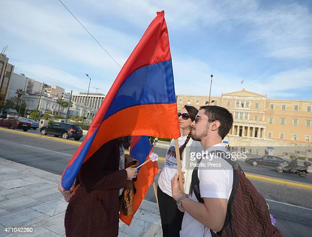 A demonstrator holds an Armenian flag in front of the Greek parliament Armenians that live in Greece organised a demonstration to remember the 15...