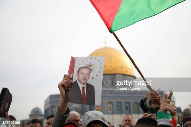 Demonstrator holds an image of President of Turkey Recep Tayyip Erdogan during a demonstration against U.S. President Donald Trump's recognition of...