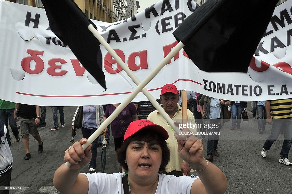 A demonstrator holds black flags while marching in the center of Athens on June 5, 2010 during a demonstration called by two main unions against the government's austerity measures. Thousands of demonstrators gathered on June 5 in Greece to protest against a controversial, debt-dictated pension reform proposal that includes cuts, higher contributions and tougher retirement rules. AFP PHOTO/ Louisa Gouliamaki