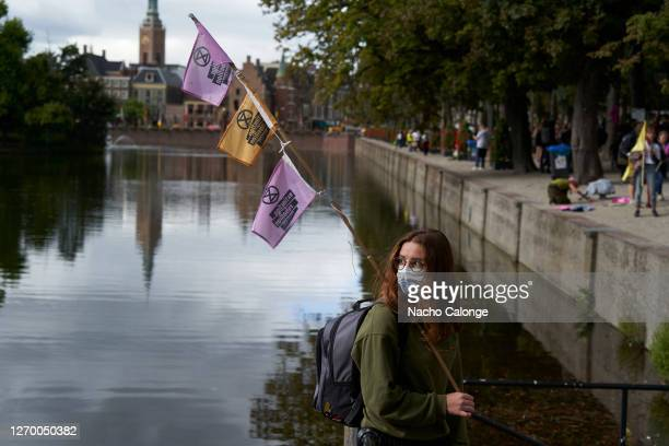 A demonstrator holds flags during a protest on September 1 2020 in The Hague Netherlands Coinciding with the start of the new political year the...