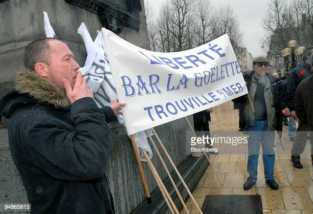 A demonstrator holds up a banner as part of a protest by bar owners against French antismoking laws in Rouen northern France on Wednesday April 2...