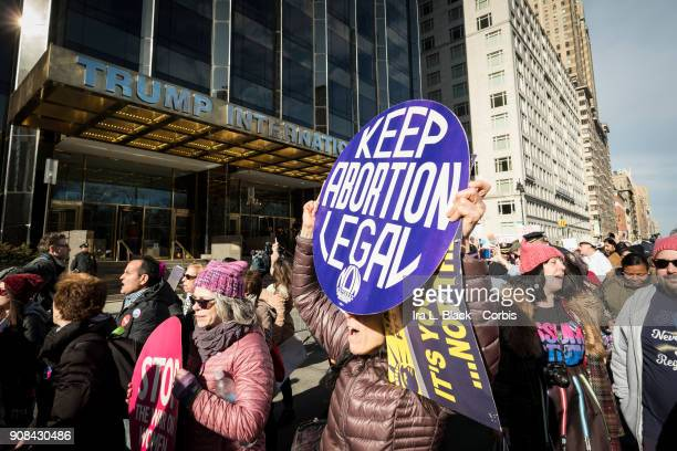 A demonstrator holds up a banner saying 'Keep Abortion Legal' in front of Trump International Hotel and Tower during the second annual Women's March...