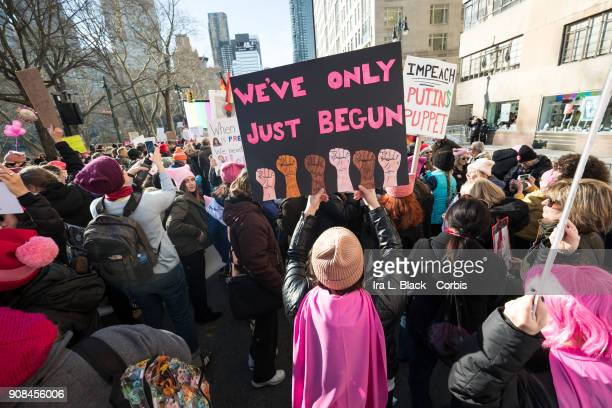 A demonstrator holds up a banner saying 'We've Only Just Begun' during the second annual Women's March in the borough of Manhattan in New York City...